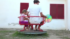 Parents and their daughter, rotating on a carousel Stock Footage