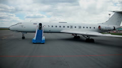 Crane shot of a plane waiting Stock Footage