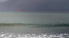 54 Waves in ocean against ship in cloudy day Stock Footage