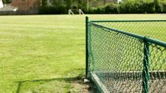 Boy climbs fence and walks away Stock Footage