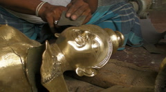 A Man Sands down an Idol in Production Stock Footage