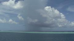 Raiatea rainshower and reef Stock Footage