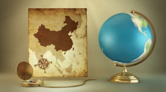 15 Turning globe, compass and ancient map of China Stock Footage