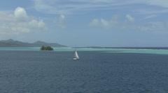 Raiatea sailboat in lagoon vista - stock footage