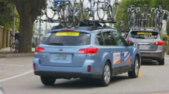 BIKE RACE CHASE VEHICLES FROM BEHIND Stock Footage