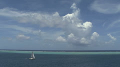 Raiatea sailboat inside the reef 1a - stock footage