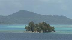 Raiatea motu in lagoon 2 Stock Footage