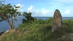 Raiatea rock by the sea - stock footage