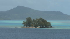 Raiatea island in lagoon - stock footage
