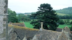 Looking at the British countryside across a castle rooftop. Stock Footage
