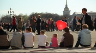Stock Video Footage of People sitting on the curb. Girl with red balloon too