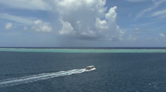 Raiatea excursion boat in lagoon 1 - stock footage
