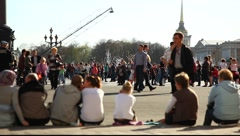 Sitting people. Crowd from pedestrians on the background Stock Footage