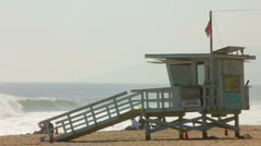 LIFEGUARD TOWER AND BIG WAVES Stock Footage