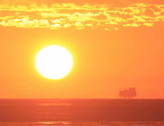 Oil platform at sunset - 01b 2k Stock Footage