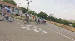 BIKERS RACE AROUND COURNER - stock footage