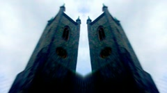 Double clock towers, blue tint monochrome Stock Footage