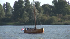 Wooden boat in dutch river - stock footage
