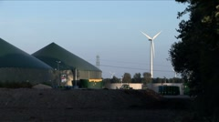 windmill next to biogas installation - stock footage