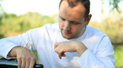 Happy handsome man drinking wine, outdoors HD Stock Footage