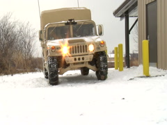 Army transport vehicle in snow Stock Footage