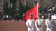 Chinese student military parade - white uniforms and flag Stock Footage