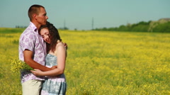 Portrait of a sweet couple in meadow. Dolly Stock Footage