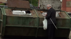 The old man rummaging in the garbage Stock Footage