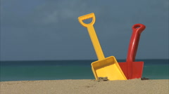 Colorful kids spades on beach Stock Footage