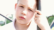 Young Child looking at camera with sad face Stock Footage