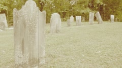 Headstones in a Lenox, Massachusetts graveyard in sepia Stock Footage