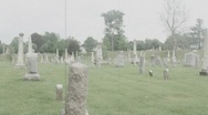 Headstones in a Massachusetts graveyard, slow pan , film effect Stock Footage