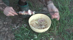 Man stick meat on a skewer. Stock Footage