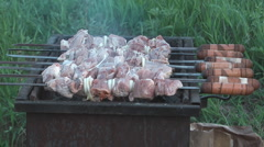 Shish kebab preparation on charcoal on a brazier. Stock Footage