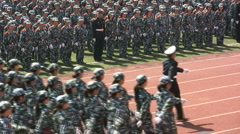 Group of students marching, China, Communism, parade, military outfit Stock Footage