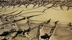 Cracked desert leading to water Stock Footage