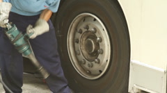 Bus tire replacement Stock Footage