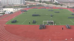 Students practicing for military parade on playground - China Stock Footage