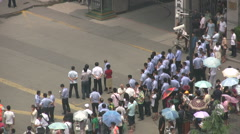 Police officers watch demonstration in China Stock Footage