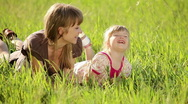 Happy mother and daughter in the grass. Family in  grass Stock Footage