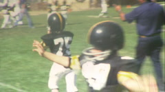 Little KIDS PLAY FOOTBALL Game Jr. High School Boys 1970 Vintage Film Home Movie - stock footage
