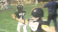 Stock Video Footage of Little KIDS PLAY FOOTBALL Game Jr. High School Boys 1970 Vintage Film Home Movie