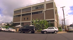 WS IHS building with cars infront Stock Footage