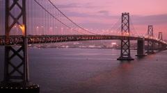 Oakland Bay Bridge Over the Bay as Night Falls in San Francisco, California Stock Footage