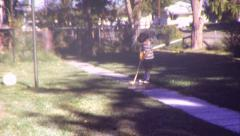 BOY GOLFING Golfer Kid Child Golf Club 1970s Vintage Film Home Movie Stock Footage