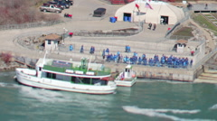 Tourists boats at niagara falls usa canada Stock Footage