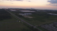Stock Video Footage of Aerial Distant City Dusk