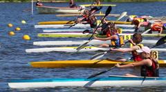 Start of a kayak race Stock Footage