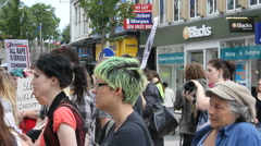 Slutwalk crowd listens to speakers - stock footage