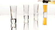Row of Four Shot Glasses Stock Footage